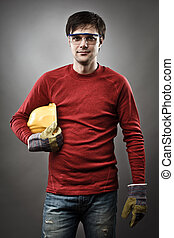 Blue collar worker with hardhat - Young blue collar worker...