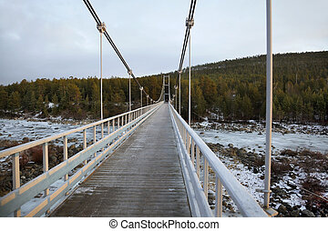 Pedestrian bridge over the river winter Landscape