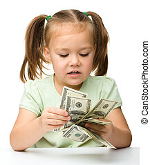 Cute little girl with paper money - dollars