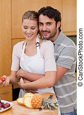 Portrait of an in love couple eating fruits