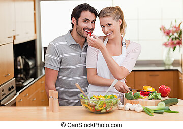 Young couple slicing pepper