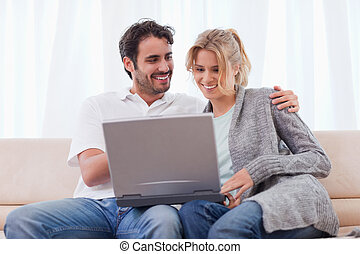 Couple using a notebook