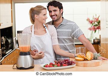 Couple making fruits juice