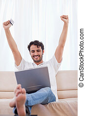 Portrait of a cheerful man shopping online