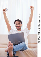 Portrait of a cheerful man buying online