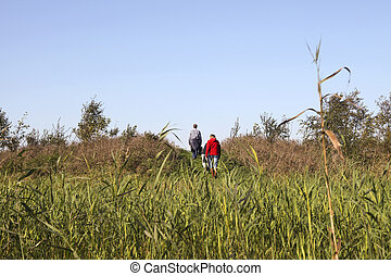 People walking in a nature reserve - Family is walking...