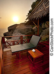 Sunbed on a terrace - Sunset sunbed on wooden terrace with...