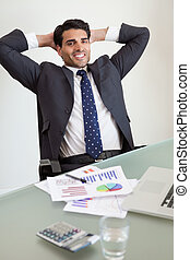 Portrait of a smiling sales person relaxing