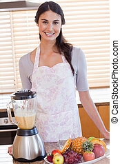 Portrait of a woman posing with a blender
