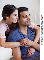 Portrait of a young couple posing in their living room