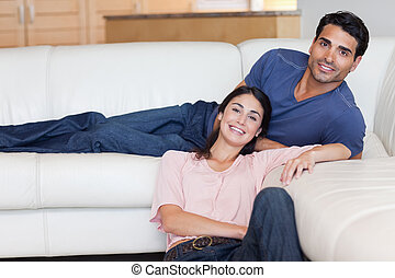 Smiling couple posing in their living room