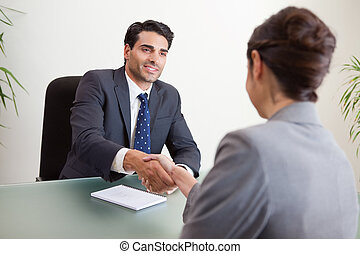 Smiling manager interviewing a female applicant