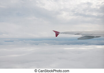 Plane above clouds - Winf of airplane above fluffy white...