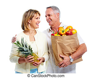 Senior couple with a grocery shopping bag. Isolated on white...