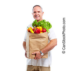 Senior man with a grocery shopping bag.