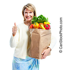 Senior woman with a grocery shopping bag. Isolated on white...