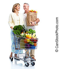 Senior couple with a grocery shopping cart. Isolated on...