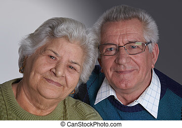 Elderly couple - Elederly couple portrait smiling, studio...