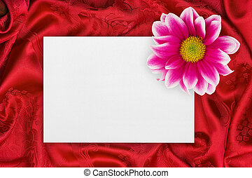 Greeting paper card and flower on red cloth - Greeting paper...