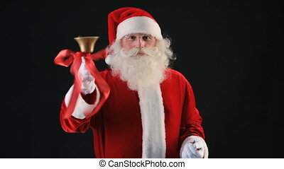 Christmas bell and glitters - Santa ringing a golden bell...