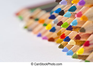 Colorful pencils on right side white isolated background