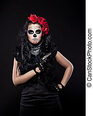 Serious woman in day of the dead mask with gun - neagtive...