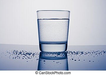 Glass of water on a blue background