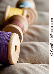 Thread bobbins on a gray fabric