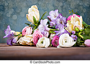 bunch of spring flowers - bunch of freesias, tulips,...