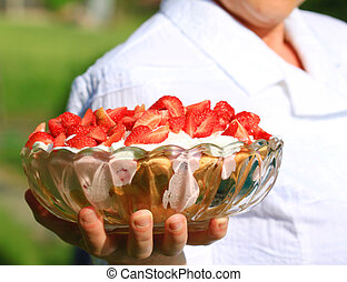Serving dessert - Woman serving delicious strawberry dessert