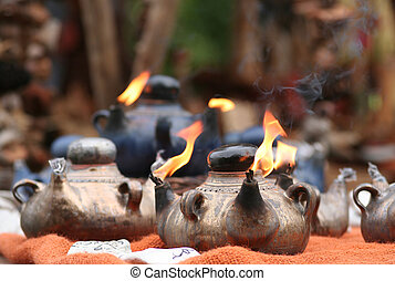 Arabic Oil Lamp with flames coming out of the pipes.