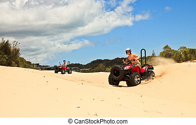 Guy and girl riding a quad bike
