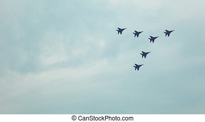 jets display team fly in formation during MAKS-2011 airshow...