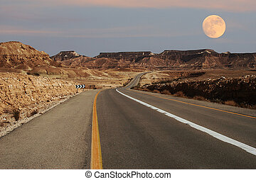 Narrow highway running through desert in Israel - View on...