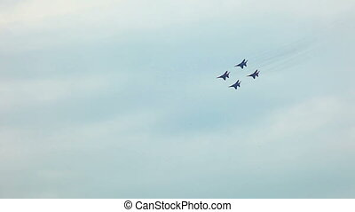 Group of fighters show team fly - ZHUKOVSKY, RUSSIA - AUGUST...