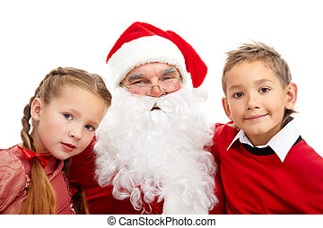 Santa with kids - Image of happy Santa between little boy...