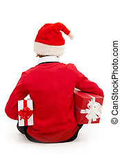 Boy with gifts - Rear view of boy in Santa cap with...