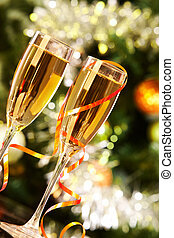 Flutes with champagne - Two champagne flutes on Christmas...