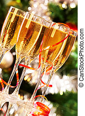 Sparkling champagne - Several champagne flutes on Christmas...
