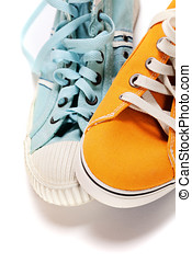 sports shoes  - two different sport shoes over white