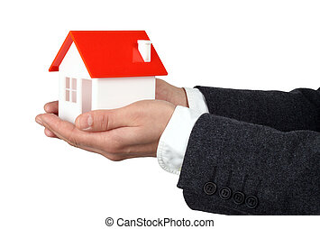 Real property or insurance concept - Hands and house model...
