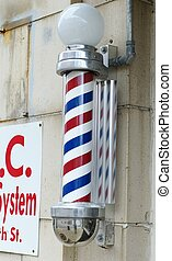 BARBER POLE - A red, white, and blue-striped barber pole