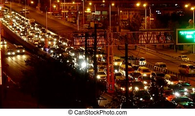 Many cars on overpass,traffic jam at night.