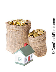Toy small house and bags with money The concept of purchase...