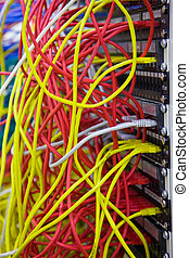 A bunch of network cables in a data center - network hub and...