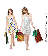 Two happy friends with purchases It is isolated, a white...