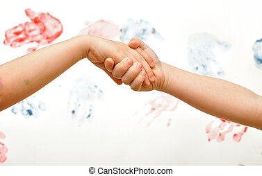 Chain of children's hands on a white background