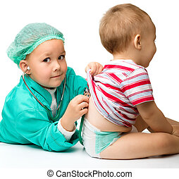 Children are playing doctor with stethoscope - Cute children...