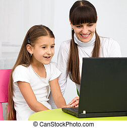 Mother an her daughter with laptop