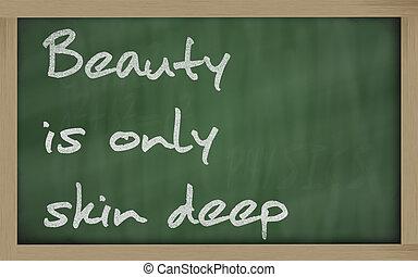 """"""" Beauty is only skin deep """" written on a blackboard -..."""
